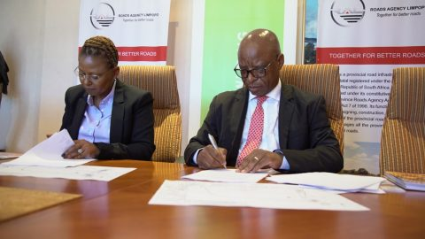 Image: Dr Nombasa Tsengwa, Executive Head of Coal Operations at Exxaro Resources (Left) and CEO of Roads Agency Limpopo Mr Maselaganye Matji (right) sign a Memorandum of Agreement (MoA) for the upgrade of a road in Lephalale, Limpopo