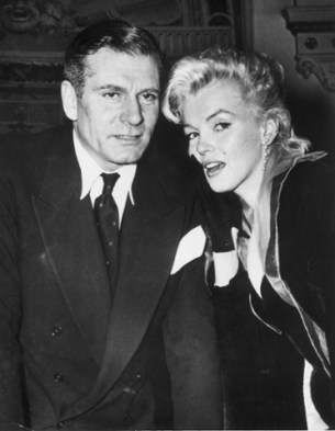 1956: American actor Marilyn Monroe (1926 - 1962) poses with British actor Laurence Olivier (1907 - 1989), possibly on the set of the film, 'The Prince and the Showgirl,' which was directed by Olivier in England.