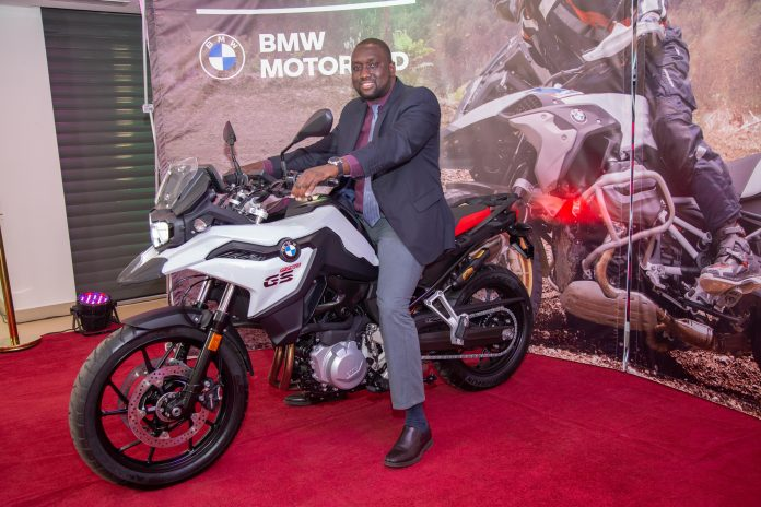 Inchcape Kenya Ltd MD Hussein Ibrahim with a BMW motorbike during the launch of the BMW Motorrad showroom