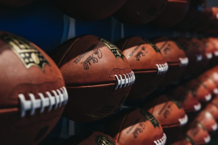Rows of american football balls in NFL Experience in Times Square, New York