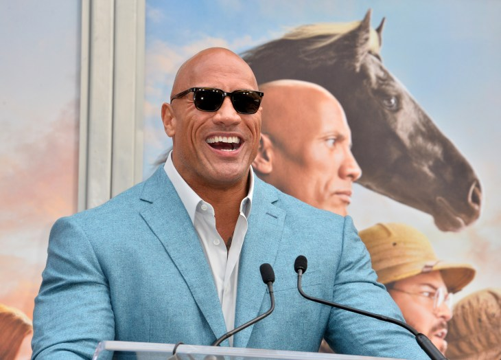 LOS ANGELES, USA. December 10, 2019: Dwayne Johnson at the handprint & footprint ceremony for Kevin Hart at the TCL Chinese Theatre. Picture: Paul Smith/Featureflash