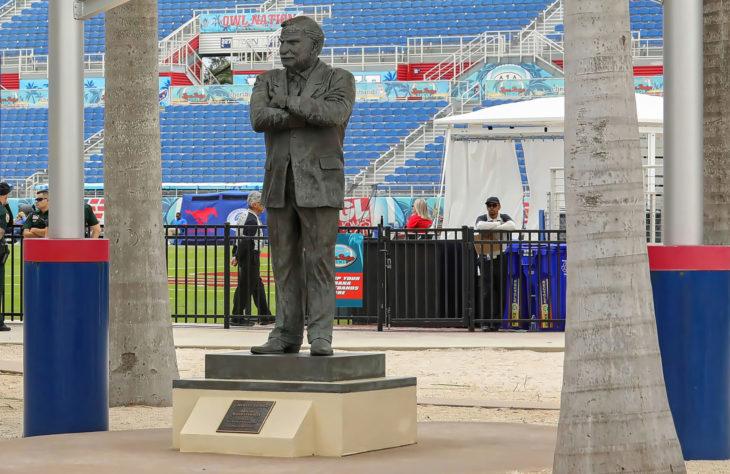 BOCA RATON, FLORIDA, USA: Bronze statue of Howard Schnellenberger, famous Florida Atlantic University (FAU) Football coach as seen at the FAU Football Stadium on December 21, 2019.