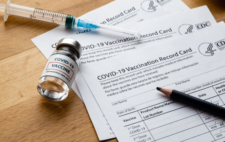 New York, USA - February 14 2021: Vaccination record card. Vaccination form during the coronavirus epidemic on the medical table