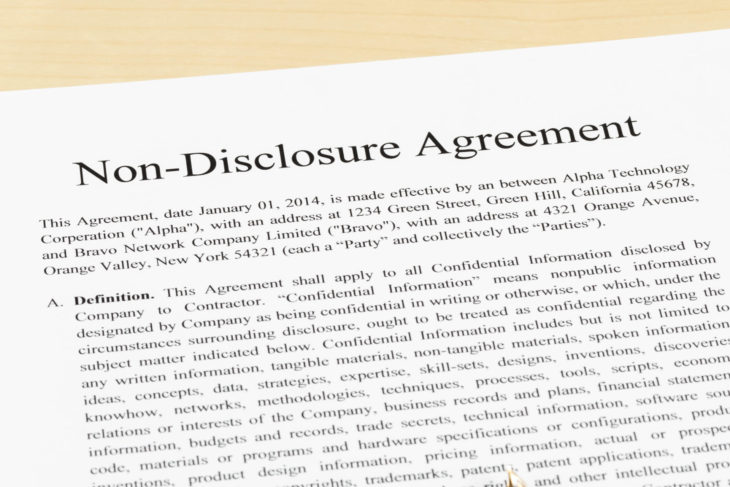 Non disclosure agreement document with pen close-up