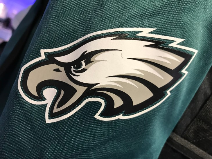 Minneapolis, MN/USA - January 30, 2018 - Closeup of the arm of an Eagles fan wearing a jersey in a store. It is purposely blurred in the front and back of the arm. The angry eagle shows his beak.