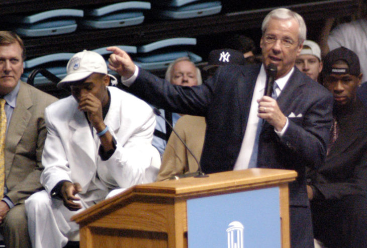 Choking up, coach Roy Williams addresses the crowd at the team welcome home ceremony at the Dean E. Smith Center for the 2005 NCAA National championship basketball North Carolina Tar Heel squad.