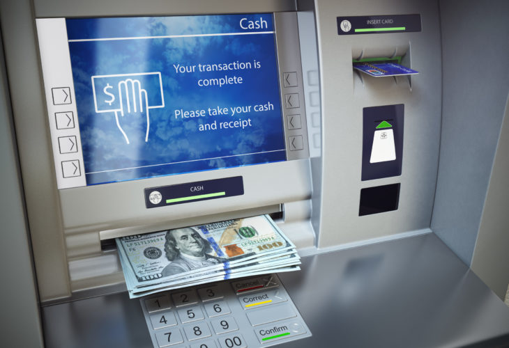 ATM machine and money. Withdrawing dollar banknotes. 3d illustration