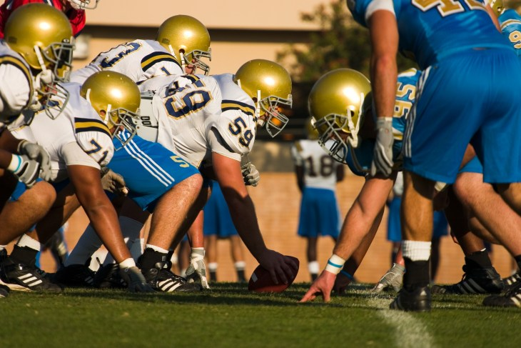 UCLA Bruin Football team on the line of scrimmage