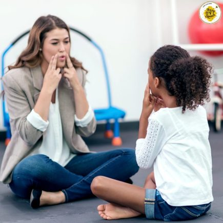 School speech therapist working with a young girl.