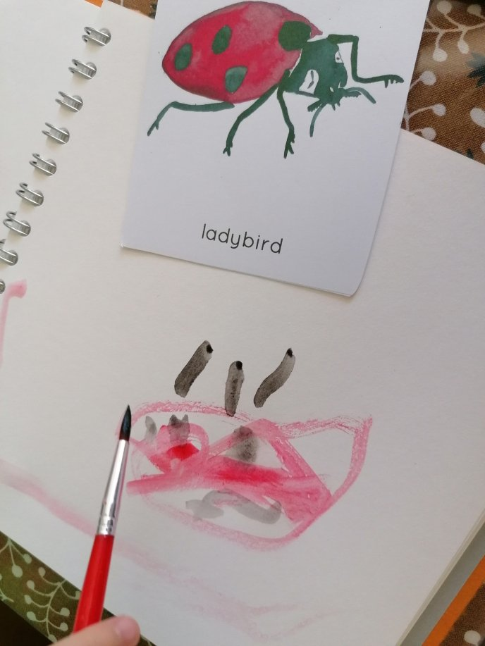 Nature journal of a ladybird water colour painted by three year old Floss