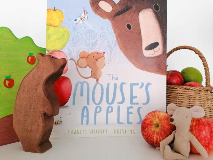 The Mouse's Apples by Frances Stickley and Kristyna Litten front cover with basket of read and green apples, mouse and bear prop
