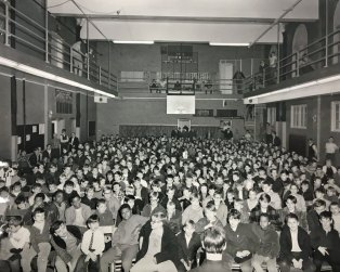Vintage photo of gym filled with boys