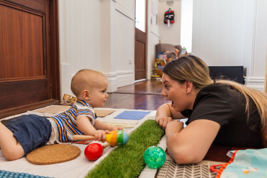 Buttercups Day care teacher playing with Kid