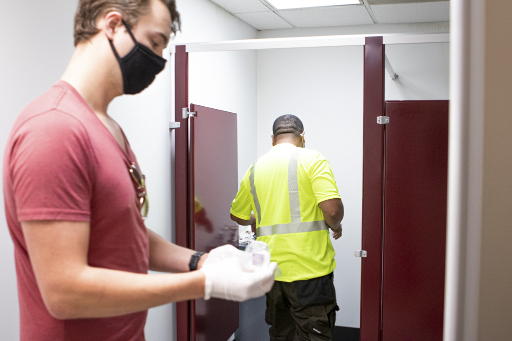 Butterfield Onsite Drug Testing collector waits for a newly hired employee to pee into a urine drug test cup.