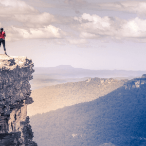 Person standing on a cliff-Are you feeling Vulnerable?