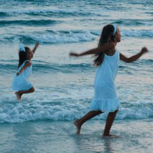 Girls on beach-what makes a good friend