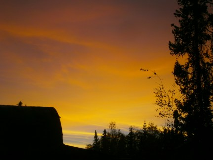 Boy captured this sunset over our neighbor's quanset hut.