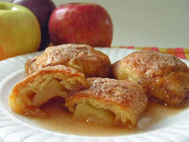 Country Apple Dumplings made easy with few ingredients- an apple, brown sugar, crescent dough & lemon lime soda! Simple recipe for apple dumplings in caramel sauce that everyone loves.