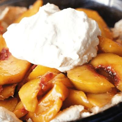 Easy Peach Pie is one of my favorite recipes for fresh peaches! Our simple recipe for pie crust will blow your mind- can you believe that secret ingredient?!  Try it and you'll see just how delicious it is.