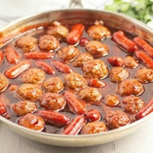 Easy Meatball appetizer recipe made with an incredible 3 ingredient sauce that everyone raves about! Combine frozen meatballs & Lil Smokies in this simple & delicious appetizer recipe perfect for parties.