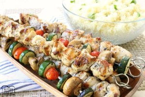 Simple recipe for Greek Chicken Souvlaki grilled to perfection and served with Greek lemon rice. Perfect weeknight dinner for anyone who loves the fresh, bright flavors of Greek food.