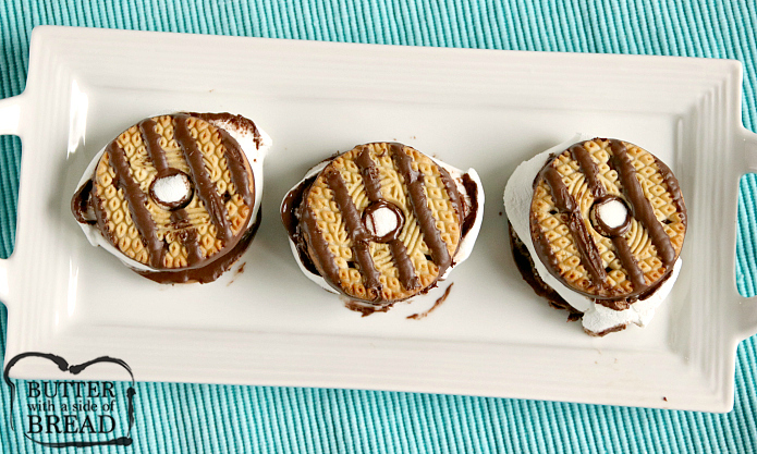 Fudge Striped Cookie S'mores have the perfect balance of cookie, marshmallow and chocolate! Make these s'mores in the oven, microwave or around the campfire!