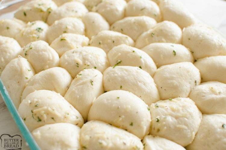 Easy Parmesan Garlic Dinner Rolls made from frozen rolls and tossed with butter and seasonings. Bakes in under 30 minutes, everyone loves these soft, buttery dinner rolls!
