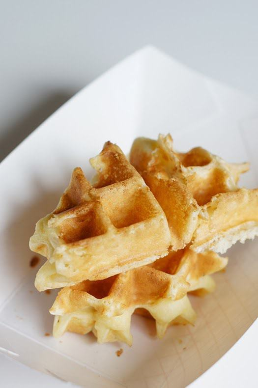 perfect, crisp, belgian waffles at butter with a side of bread