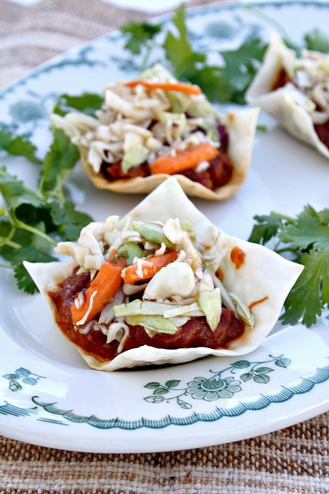 I recently had these appetizers at a book club meeting and absolutely loved them! They are simple, but unique and I never would have thought to combine these flavors together but it works so well. I cheated when I recreated the recipe and used pre-made BBQ chicken, but you can make your own easily in a crockpot with your favorite BBQ sauce.