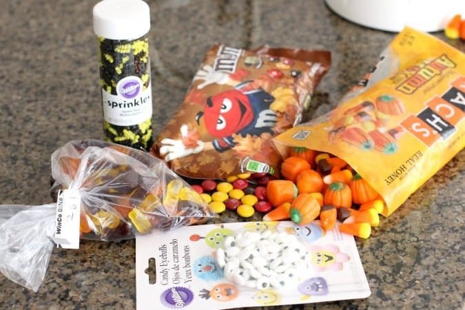 Halloween Popcorn is the perfect snack for the fall - you can't go wrong combining buttery popcorn and Halloween candy!