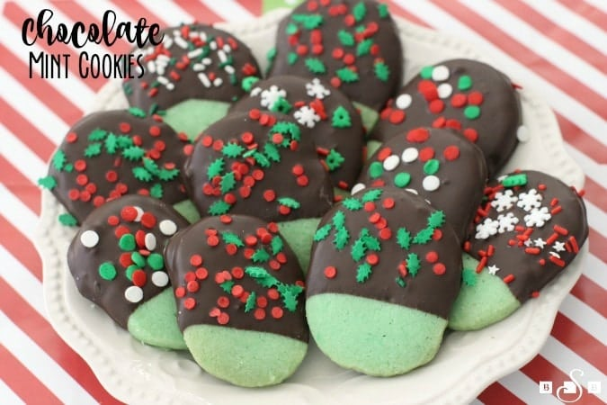 Chocolate Mint Cookies made from a buttery mint shortbread cookie dipped in dark chocolate & topped with festive holiday sprinkles.My favorite Christmas cookie!