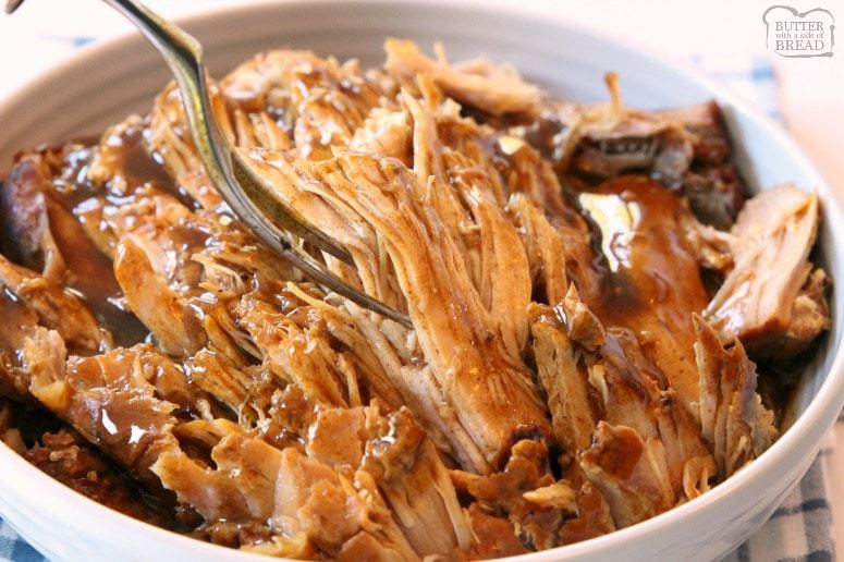 Slow Cooker Pork Roast made with simple ingredients you have in your pantry! Fall-apart tender pork with a flavorful gravy on top make this recipe amazing.