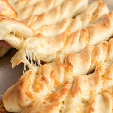 Cheesy breadsticks are a delicious side to a meal and these soft and buttery breadsticks with cheese inside can be made in under an hour!