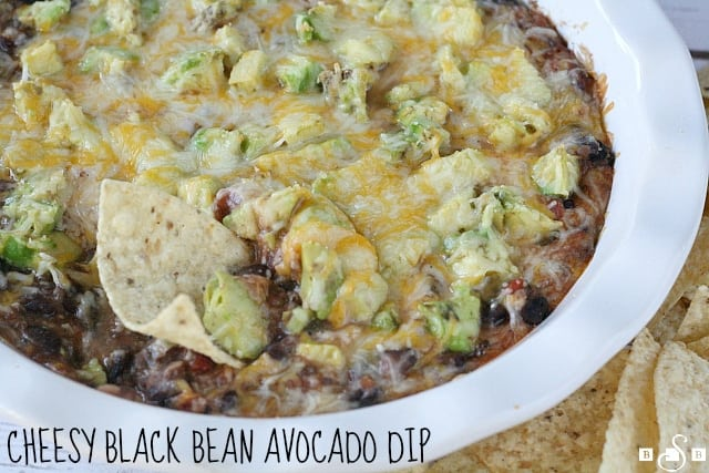 Cheesy Black Bean Avocado Dip is delicious and is made with only four ingredients, making it the perfect appetizer for any party!