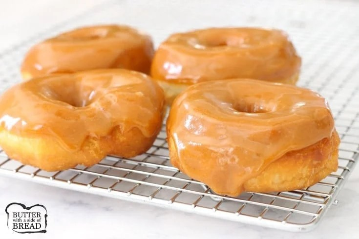 Pumpkin Spice Donuts made in minutes with crescent dough & an incredible pumpkin spice glaze. Hot &fresh donuts are easy to make & are a perfect Fall treat.