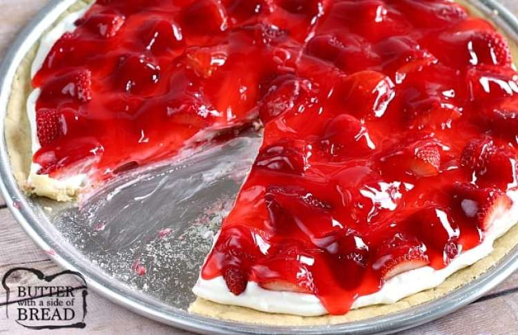This delicious Glazed Strawberry Fruit Pizza is made with pre-made sugar cookie dough topped with a cream cheese layer, fresh strawberries and a strawberry glaze!