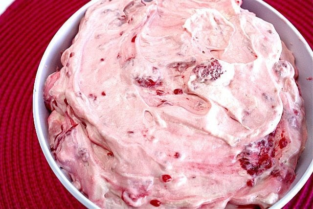 Raspberry Vanilla Jello Salad is one of the easiest recipes you will ever make and it's perfect as a side dish or even dessert!