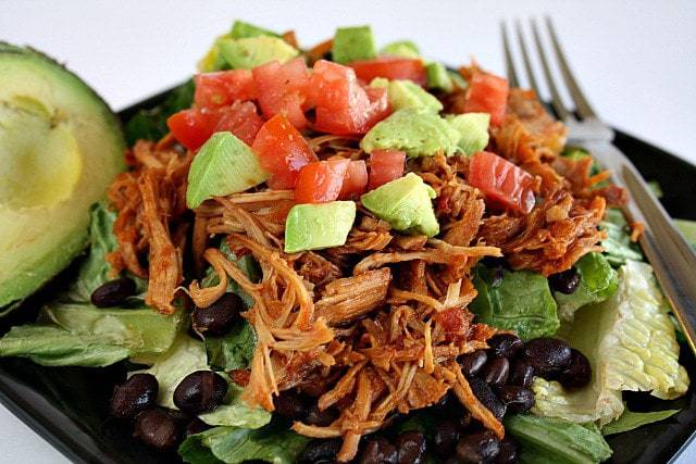 Easy Slow Cooker Sweet Pork requires just 3 ingredients and a slow cooker! Serve in tortillas, on a salad, or as a sandwich as an easy, no-fuss meal.