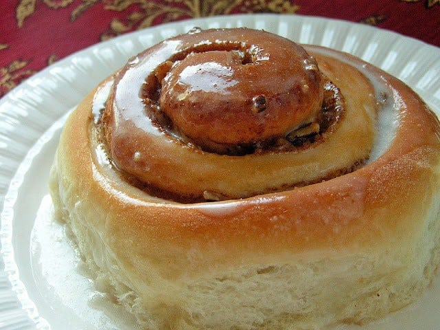 Cinnamon Rolls made from scratch that yields feather-light sweet rolls with pecans, cinnamon and a lovely vanilla glaze. Best cinnamon roll recipe ever tried!