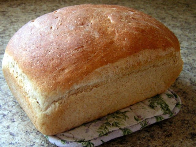 Homemade Bread made with simple ingredients you can find anywhere! Bake a loaf of easy, fresh, homemade bread to serve alongside dinner tonight.