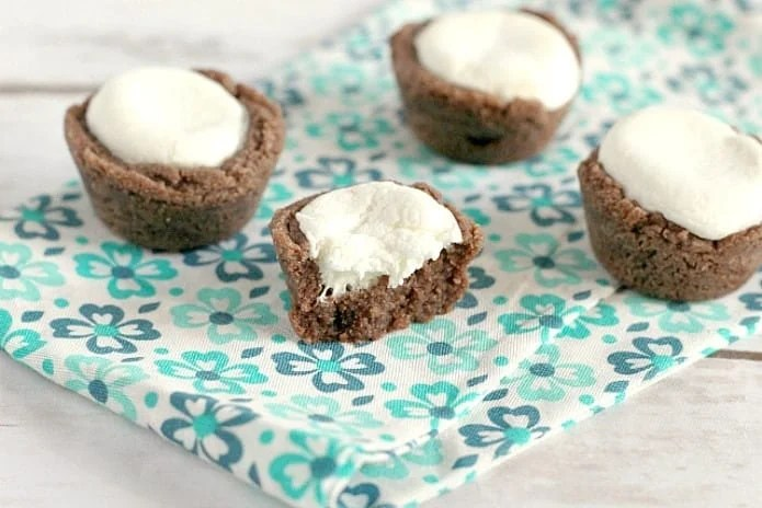 Hot Chocolate Marshmallow Cookie Cups are easily made with a sugar cookie mix, hot chocolate mix, marshmallows and a few other basic ingredients! The perfect winter treat!