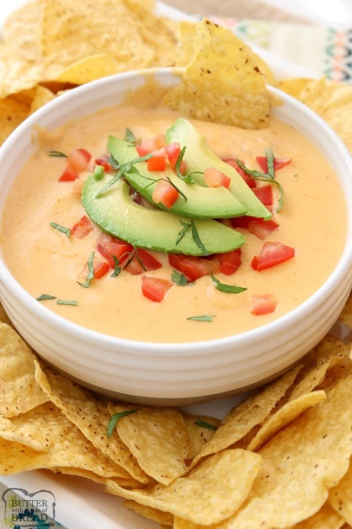 Easy Nacho Cheese sauce recipe with only 4 ingredients and is made in minutes! Smooth, creamy with great nacho cheese flavor, this recipe is perfect for parties, busy weeknight dinners and game day food!