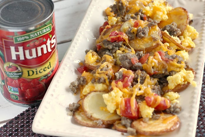 Breakfast Nachos are perfect for breakfast, but also make a wonderful lunch or dinner too! Thinly sliced roasted potatoes topped with sausage, scrambled eggs, cheese and tomatoes - an easy meal that can be ready in 30 minutes!