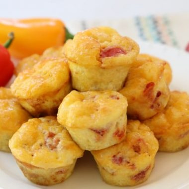 Fiesta Egg Bites are perfect for a hearty & flavorful breakfast, lunch or dinner! Simple recipe made with eggs, tomatoes, cheese and baked into bite-sized portions. Ready in under 30 minutes!