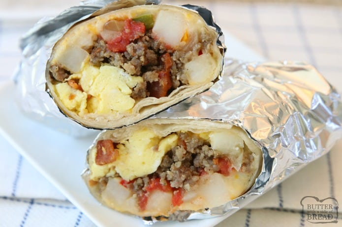 Breakfast Burrito. Loaded Breakfast Burrito recipe made with eggs, tomatoes, cheese, hash browns, sausage, bacon and more! Cook and assemble, then eat for breakfast or dinner and freeze the rest!