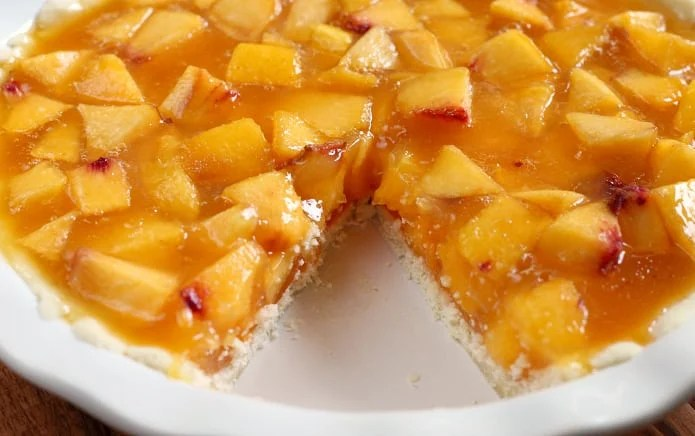 Easy Peach Pie is made with a very simple pie crust, and the filling is made with tons of fresh peaches, peach Jell-O, Sprite and a little bit of sugar. This is one of the easiest (and yummiest) pies you can make!