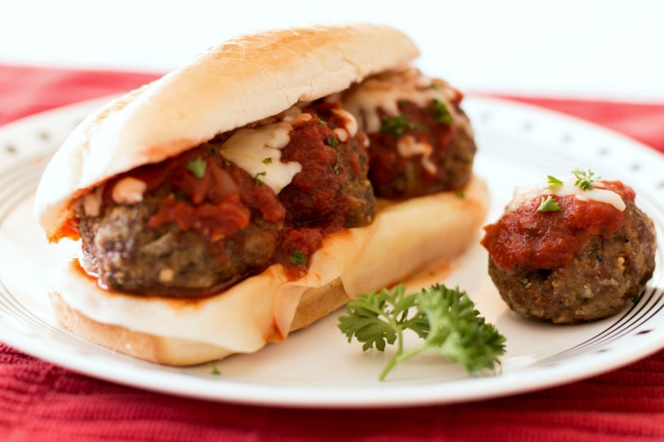 Meatball Sub recipe with flavorful, baked homemade meatballs, then assembled with 2 types of cheese, marinara sauce all on a crusty french roll. Perfect meatball sub recipe for dinner or lunch!
