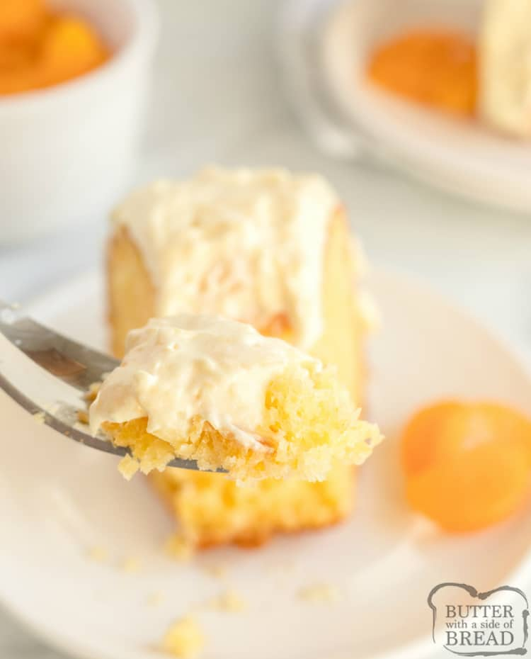 Bite of mandarin orange cake with pineapple frosting