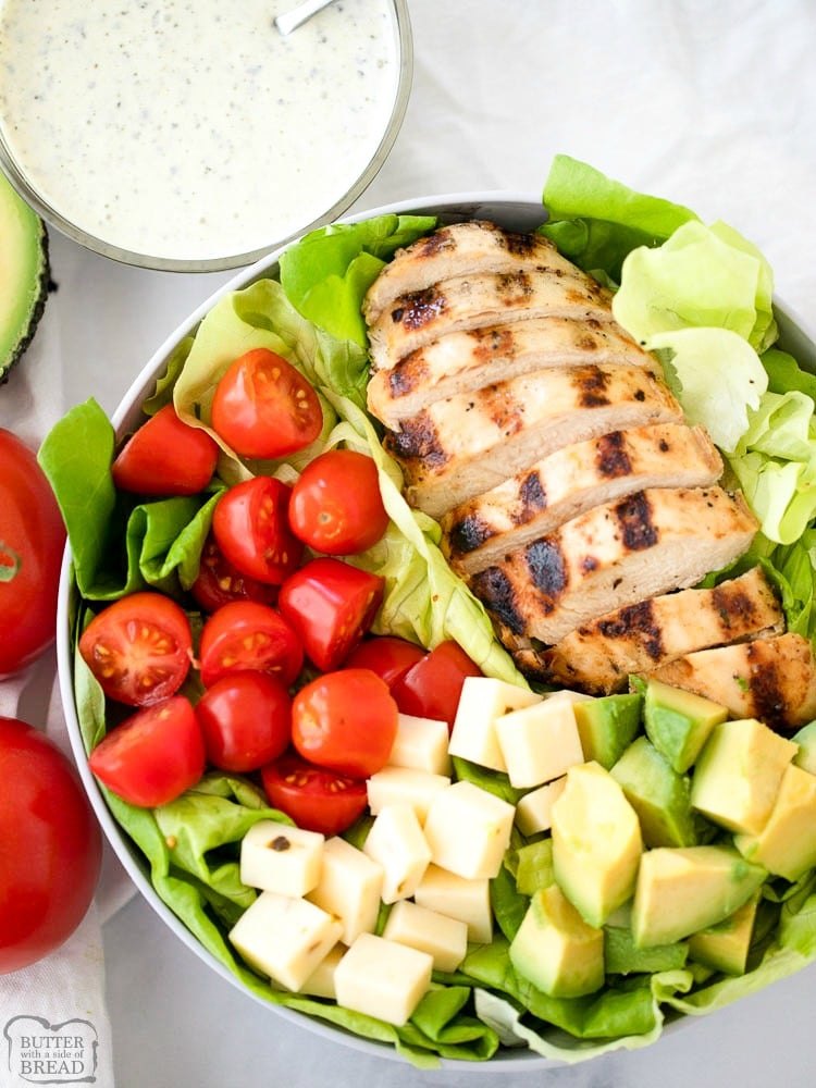 This Grilled Chicken Salad Recipe with Pesto Ranch Dressing is a quick and easy grilled chicken salad recipe.  It includes a simple grilled chicken marinade recipe that makes the most tender and juicy grilled chicken and a delicious pesto ranch dressing everyone will love.