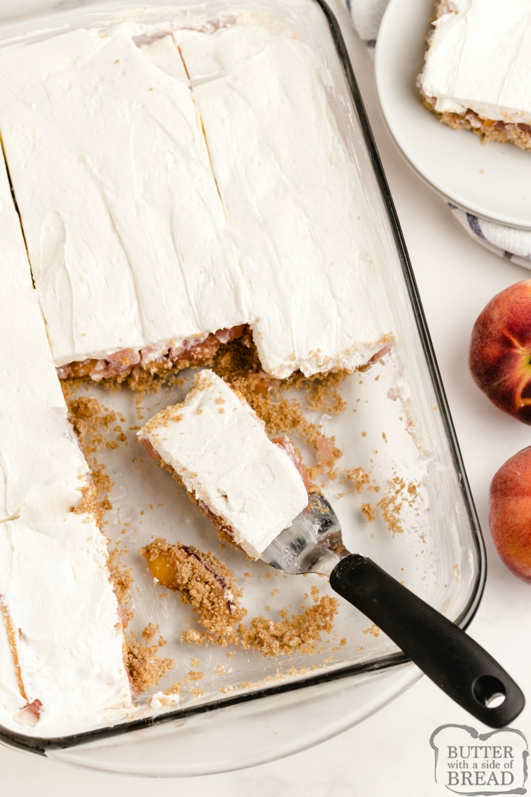 Cutting peach dessert into bars